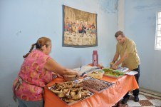 Not exactly your Lutheran Church basement meal … Here Pastor Yoelkis Gonzalez of Guanabacoa Church in Havana along with a parishioner prepare our self serve meal of chicken, black beans and rice, salad and fruit.