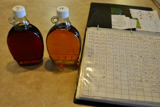 There's quite a difference in the coloring of the syrup as is shown in this photo which also highlight the old fashioned hand-written record keeping.