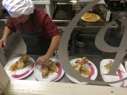 The meal at Chiquirrin Restaurant in Matanzas was suburb. Here one of the Chef is painstakingly arranging the lobster and thin deep fried potatoes that I had.