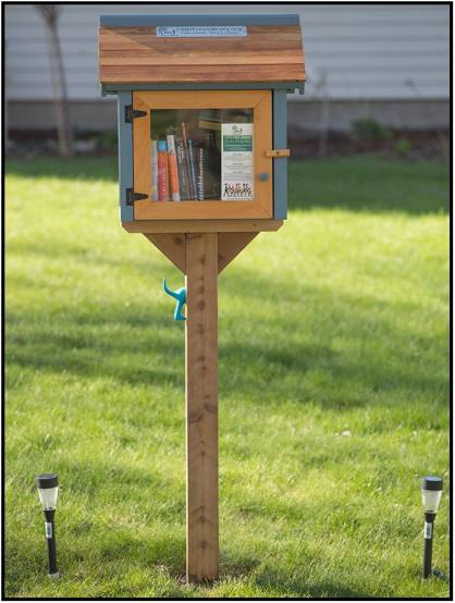 """April 22: When I want a fresh book to read, I need only go next door. This is Sheila Owen's new """"LITTLE FREE LIBRARY"""" in Bloomington, Minn."""