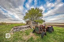 """May 19: """"Country Roads & Old Farmsteads of the Past."""" Nice clouds, an old tractor, and a tree growing out of this old farm shed made for an interesting composition."""