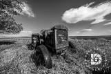 "May 19: ""Country Roads & Old Farmsteads of the Past."" Interesting old tractor image done in black & white. Notice the old crank handle still in the front. I tried to crank but it would not budge!"