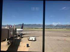 June 25: Heading home — the view today from Bozeman's airport. Yup, that's our plane to Minneapolis.