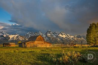 "June 23: ""The Moulton Barns on Mormon Row"": Wider shot of this iconic barn and the Tetons in the background."