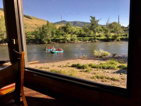 "June 23: A River Runs Through It — Kristi and l had dinner tonight at a high-end restaurant on the shore of the Clark Fork River in Missoula. I shot this iPhone pic from our table. Steak, of course: This IS Montana, after all. We're heading home soon, so splurged a bit. I thought of the movie ""A River Runs Through It,"" based on a story by Norman MacLean. THAT river is the Big Blackfoot River, which connects to the Clark Fork not far from Missoula. It reminded me to read more of McLean's work when I get home."