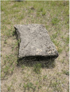 One of the foundation stones for Roosevelt's cabin, a sandstone slab.