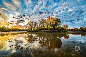 """""""Around the River Bend"""": Shot this scene several different days in the evenings and mornings, but this particular morning sunrise image had the best clouds scattered in the sky and reflecting in the Red River."""