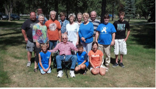 The patriarch, with his extended family, Bismarck.