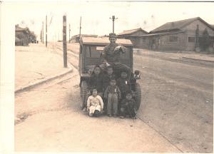 Garland Crook with Korean children, Korean Conflict.