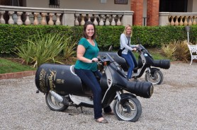 Andrea (left) and Nicole Wood have fun on the specialized Freixenet motorbikes.