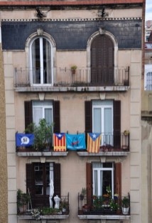 Pro-Catalonia separation flags in an apartment photographed from Andrea's terrace.