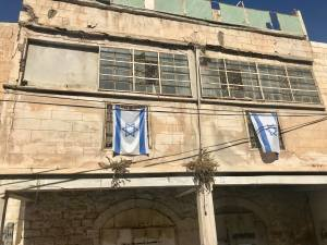 Israeli flag staking claim to Palestinian property.