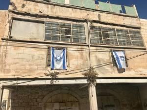 Israeli flag staking claim to Palestinian property.