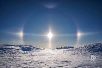 Snow patterns with the sun dogs.