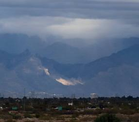 I could also look 20 miles to the northeast and see that the Catalinas, an even larger range than the Santa Ritas, were getting some rain, as well as a few shafts of sun. Most of the city of Tucson lies between here and there.