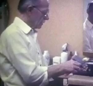 "Al Thielman demonstrates honing a straight-edge razor in this still from the film ""Razor."""