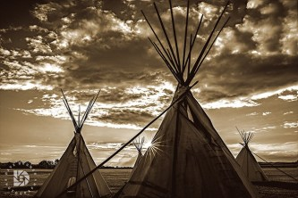 A sunset image of these Teepees depicts a nostalgic scene of what it might have looked like on the Great Plains of the now past Old Frontier. A beautiful sky with the sun rays bursting its rays on the side of this Teepee at sunset completed this composition. I chose a Sepia Tone for this scene as it gives it an old style look to this photo.