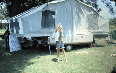 That's me, holding the big catfish. That's our pop-up camper from that era.