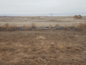 Propose Davis Refinery site. The best little weed patch in Billings County. The earth mover has been sitting there since October 2018.