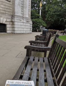 I sat on this bench outside St. Paul's after Morning Prayer, waiting for admittance time for self-guided audio tours and reading Times from this pleasant spot.