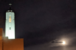 Lillian's photo of the Cathedral bell tower and the cloudy pink moon.
