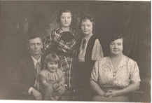 Andy and Lillian Silbernagel with their three daughters. Marian on his father's lap, Lauretta (center), and Junette (center right), circa 1934.