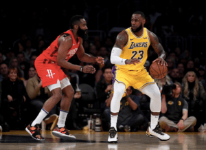 The Los Angeles Lakers' LeBron James (23) works against the Houston Rockets' James Harden during a 111-106 Laker win at Staples Center in Los Angeles on Feb. 21, 2019. (Harry How/Getty Images/TNS)