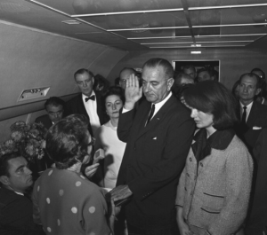 Lyndon B. Johnson sworn in as president of the United States on Air Force One following President John F. Kennedy's assassination. Nov. 22, 1963. (LBJ Library)