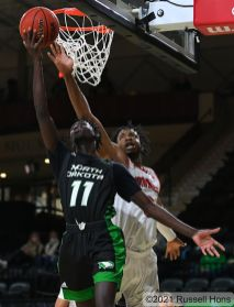 February 14, 2021: a NCAA men's basketball game between the University of South Dakota Coyotes and the University of North Dakota Fighting Hawks at Betty Engelstad Sioux Center in Grand Forks, ND. Photo by Russell Hons