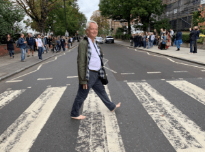 The author walking across Abbey Road in St. John's Wood, London. (Photo courtesy of Clay Jenkinson)