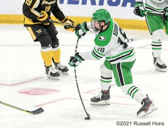 March 26, 2021 The American International Yellow Jackets take on the University of North Dakota Fighting Hawks in the second semi-final of the NCAA Men's Hockey Mid-West Regional at Scheels Arena, Fargo, ND. North Dakota won 5-1. Photo by Russell Hons