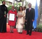 First Lady Margaret Kenyatta diplaying her award 2014
