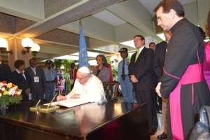 Pope signing visitors book