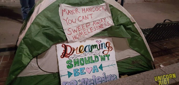 Denver Intensifies Sweeps of Unhoused Community and Confiscates Survival Gear; Parade of Rights Rally