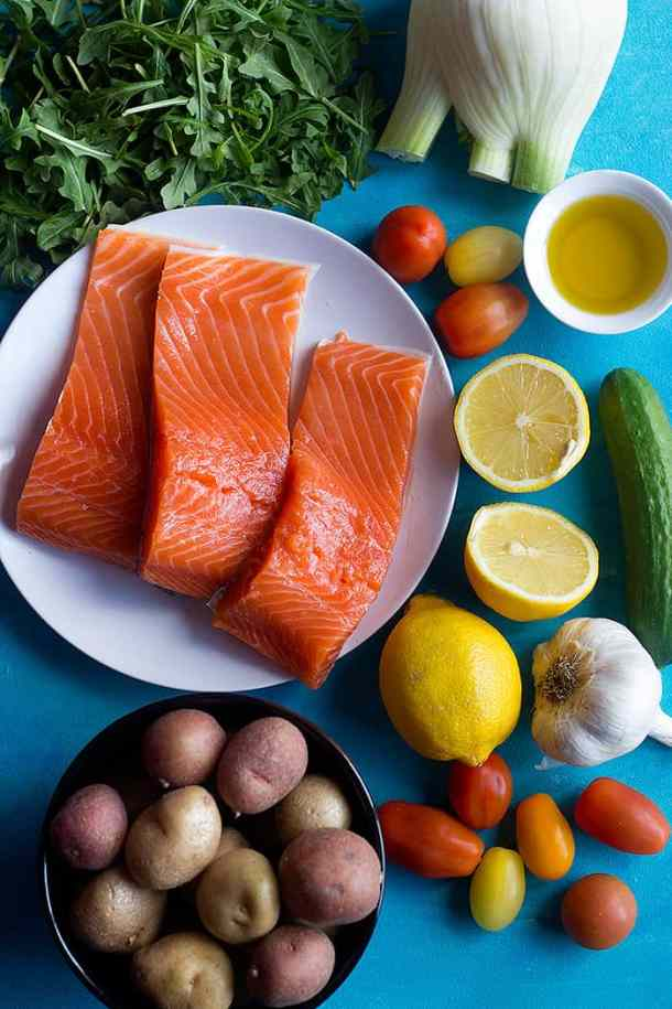 To make Baked salmon fillet with lemon  you need salmon fennel potatoes lemon olive oil and garlic.