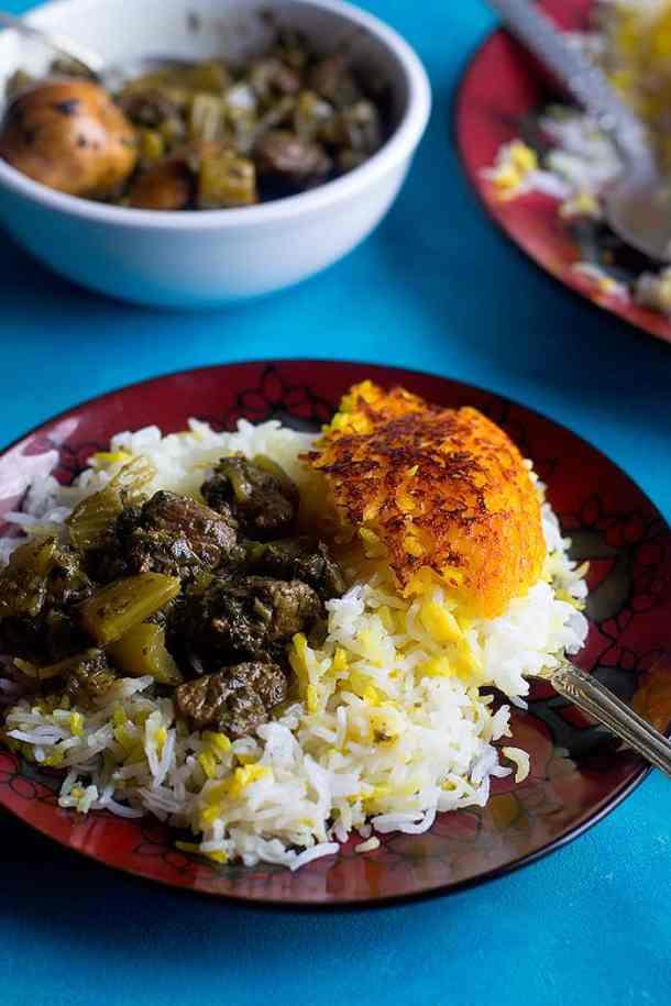 Serve rice and celery stew khoresht karafs on a plate.