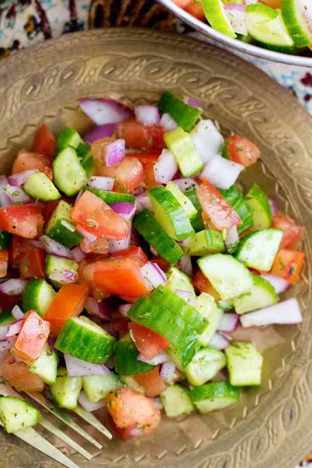 Salad Shirazi - Plump tomatoes and fresh cucumbers go well with red onion. This gluten free, vegetarian salad is perfect with any rice dish.