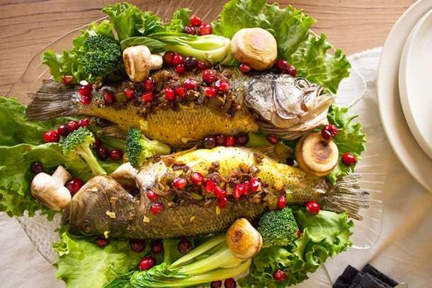 Whole fish stuffed with pomegranates and walnuts makes the perfect dish.