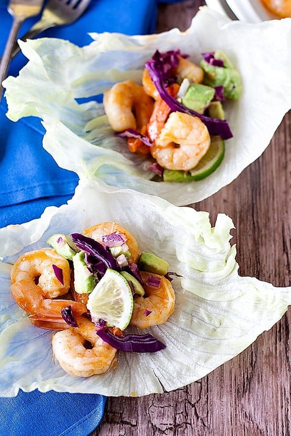 Make these Sriracha Lime Shrimp Lettuce Wraps to enjoy a light meal with some heat and cool it down with a refreshing avocado cabbage topping!