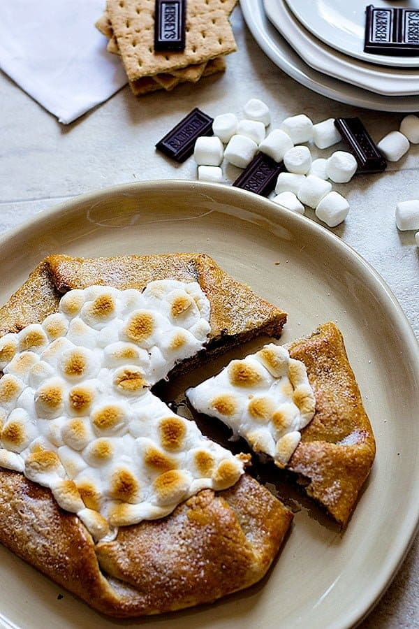 S'mores are delicious in any shape or form. Make this super easy S'mores Galette with graham crackers crust and enjoy a wonderful summer!