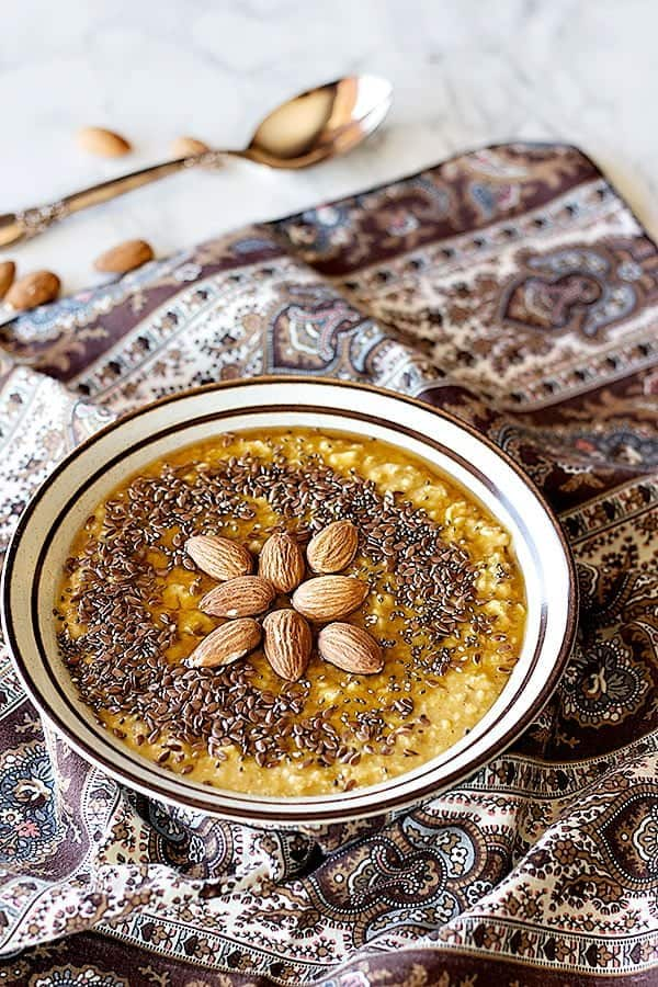 Celebrate fall with this pumpkin pie almond oatmeal that is easy and healthy. You can make it on the stove or in the microwave, and adding the almonds will give it a great crunch!