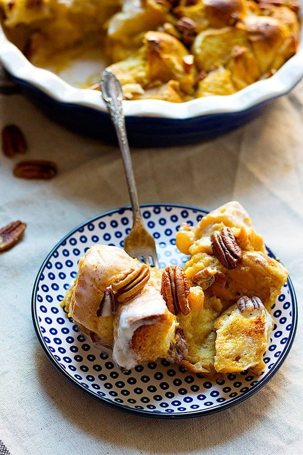 Pumpkin Pecan Bread Pudding is perfect for both dessert and breakfast. It's served with a coconut maple icing and is jam-packed with fall flavors!