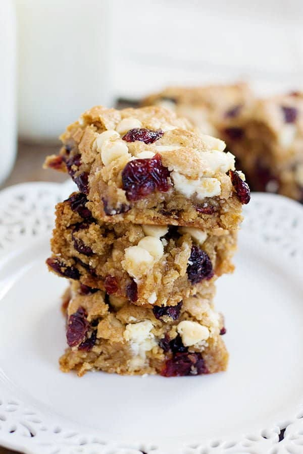 These Cranberry White Chocolate Oatmeal Cookie Bars have all the good flavors in one single bite! Sweet and tart cranberries go very well with festive white chocolate morsels!