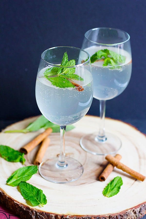 This Persian Cinnamon Mint Refresher will be your new favorite drink to serve at parties. A concentrated syrup infused with mint and cinnamon mixed with sparkling water for the right amount of fizz.