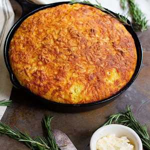 This Rosemary Cheddar Corn Bread is moist and full of delicious flavors. It's packed with aromatic rosemary baked in a cast iron skillet and has a beautiful crispy crust.