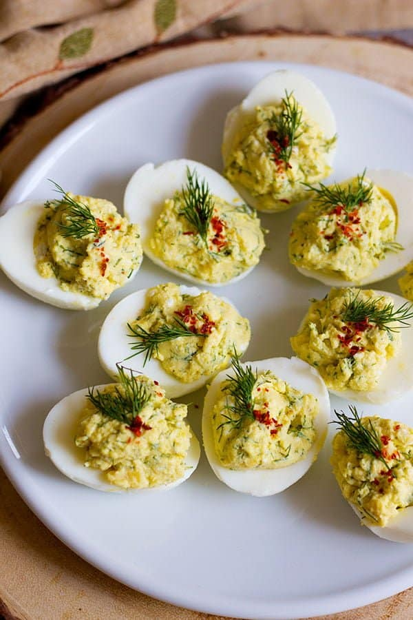 Mediterranean Deviled Eggs are the perfect twist on your favorite appetizer. The herbs and spices in this recipe make a refreshing dish that's quick and tasty!