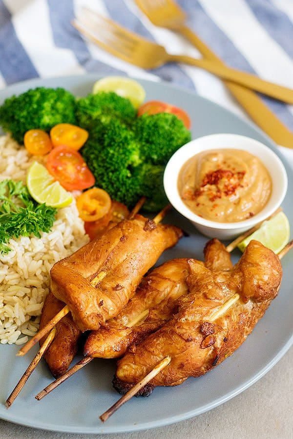 Make these delicious Thai Chicken Skewers with Spicy Peanut Sauce for an amazing family-friendly meal. The marinade is the key to these juicy and tasty skewers.
