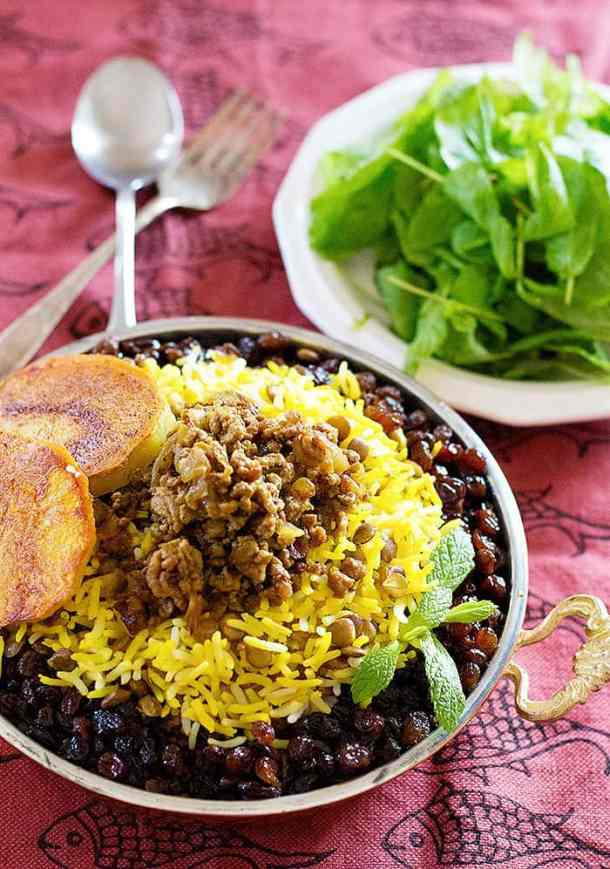 Persian rice with lentils is easy and simple to make and is topped with ground beef and saffron rice.