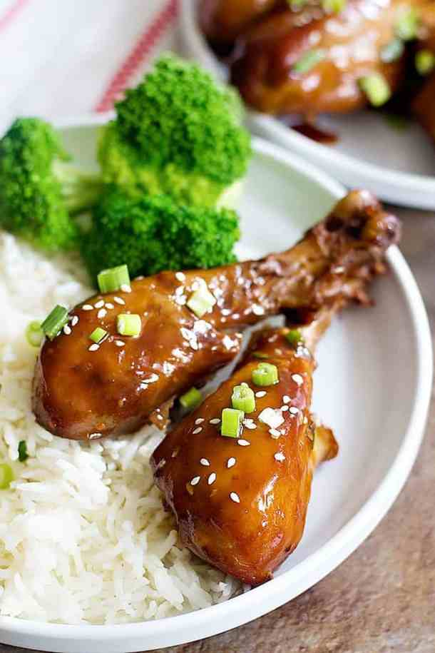 Garlic honey chicken cooked in slow cooker and topped with green onions and sesame seeds.
