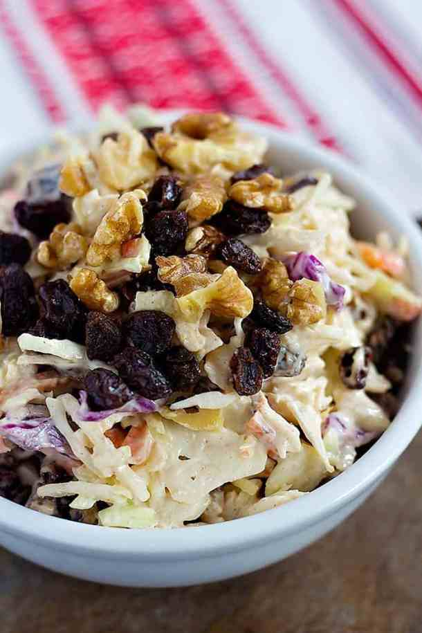 Walnut Raisin Coleslaw will be your new favorite barbecue side dish. Crunchy walnuts and sweet raisins give an extra layer of texture and flavor to your coleslaw!